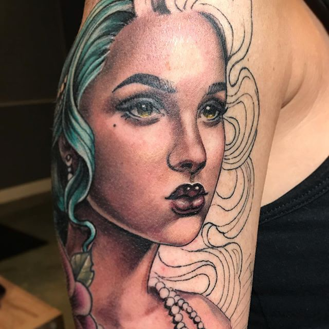 Color portrait tattoo of a woman with green hair - tattoo by tattoo artist Madison Tease of Sacred Mandala Studio.