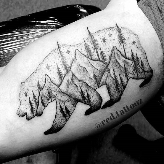 Mountain and Trees in a Bear Outline tattoo created by Ray Durham of Sacred Mandala Studio in Durham, NC.