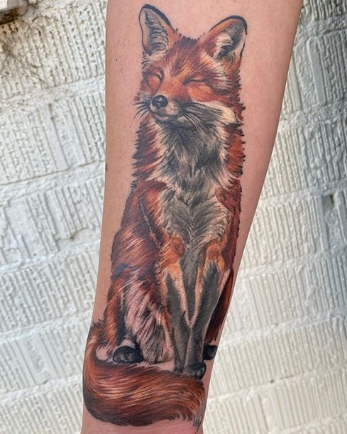 Tattoo of a red fox created by tattoo artist Madison Tease of Sacred Mandala Studio. Madison is available for bookings in Durham, NC at Sacred Mandala Studio - Tattoo Shop and Art Gallery.