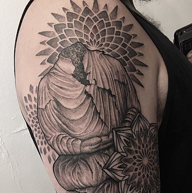 Custom Upper Arm Tattoo of a Headless Buddha Statue Surrounded by Mandalas. Tattoo created by Tattoo artist Alan Lott at Sacred Mandala Studio. Premium Custom Tattoo Parlor and Art Gallery for the Triangle of North Carolina. Raleigh, Durham, Chapel Hill.