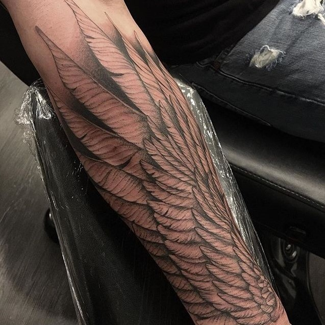 Forearm black and grey Tattoo done by Tattoo Artist Alan Lott of Wings. Intricate clean lines form the feathers of this custom tattoo. Alan Lott is available for custom tattoos in the Triangle of North carolina (Raleigh, Durham, Chapel Hill) at Custom Tattoo Parlor and Art Gallery, Sacred Mandala Studio.