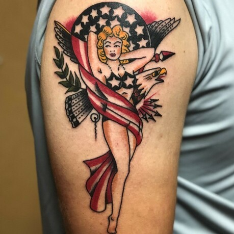 Classic American Pinup girl tattoo done in color with an eagle in the background by Tattoo Artist Jerry Martin II of Sacred Mandala Studio - tattoo studio and art gallery in the Triangle, NC (Durham, Raleigh, Chapel Hill).