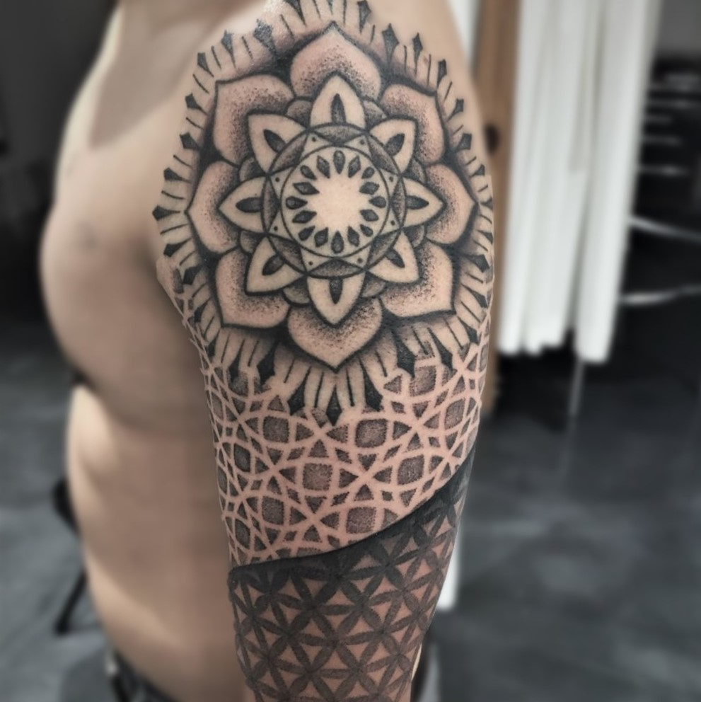 Mandala arm sleeve tattoo done in black and grey by tattoo artist Alan Lott at Sacred Mandala Studio in Durham, NC.