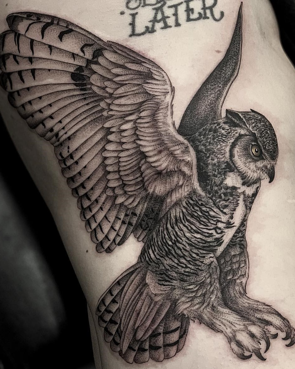 Owl Mid-Flight Side Rib Cage Tattoo in Black and Grey done by Tattoo Artist Alan Lott at Sacred Mandala Studio.
