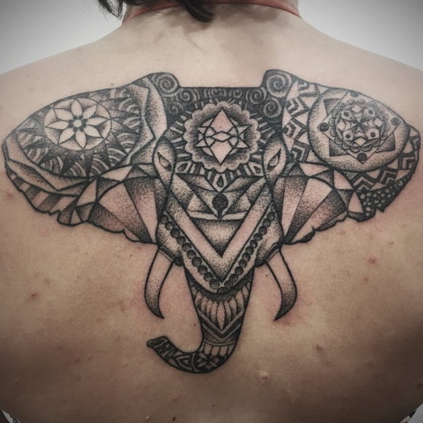 Black and Grey Tattoo by Tattoo Artist Alan Lott of a Mandala Geometric Elephants Head on the upper back. Created at Sacred Mandala Studio in Durham, North Carolina. Home of Custom Tattoos and Art Gallery in the Triangle - Raleigh, Durham and Chapel Hill, NC