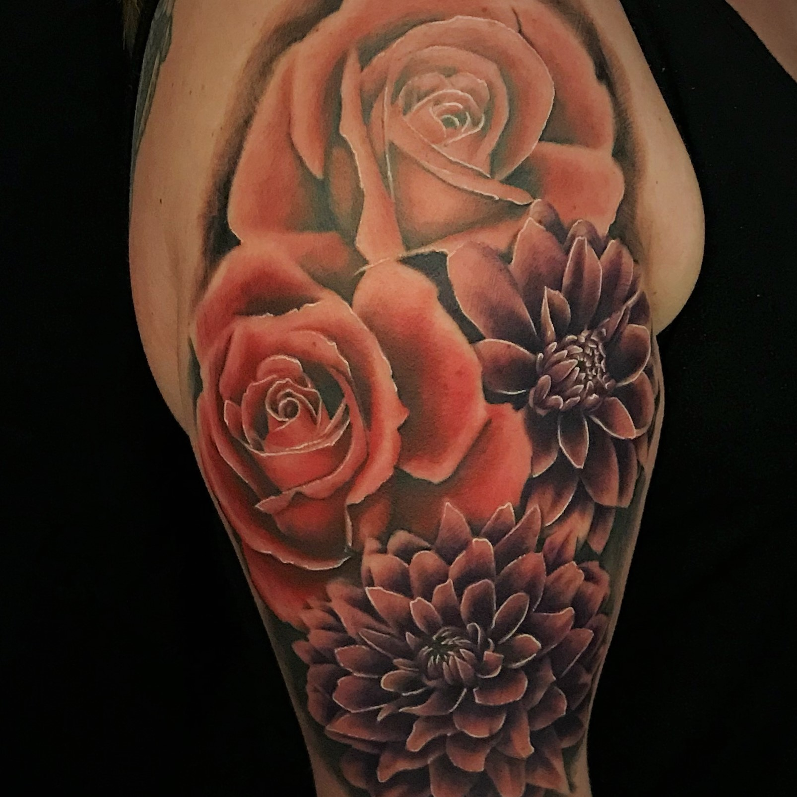 Pink Roses and Purple Dahlia flower upper arm and shoulder tattoo created by tattoo artist Alan Lott of Sacred Mandala Studio in Durham, NC.