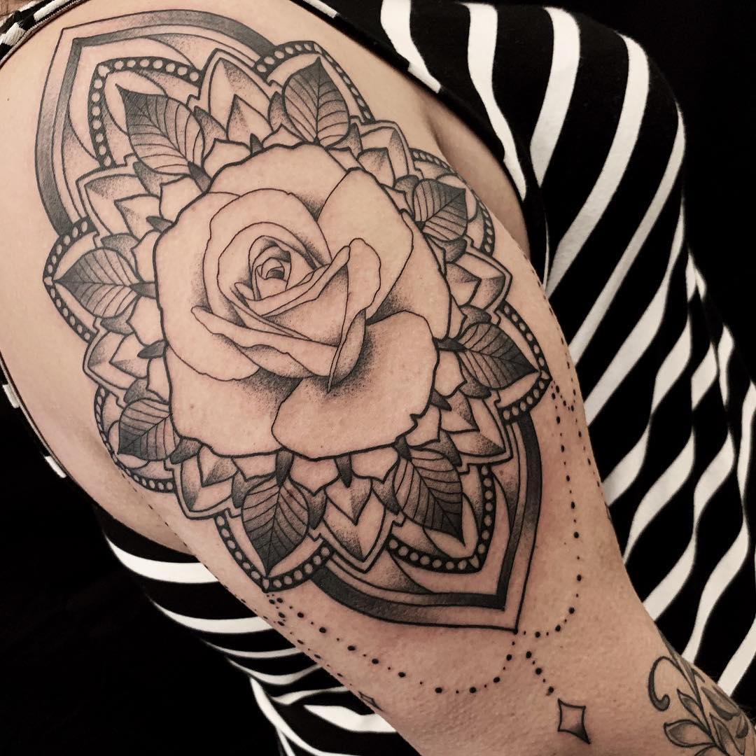Upper Arm Tattoo in Black and Grey of a Rose Surrounded by a Mandala done by Tattoo Artist Alan Lott at Sacred Mandala Studio in Durham, NC.