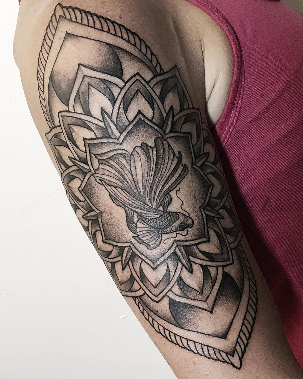 Tattoo Artist Alan Lott created this Beta Fish Mandala Upper Arm Tattoo in Black and Grey at Tattoo Studio and Art Gallery Sacred Mandala Studio in Durham, NC.