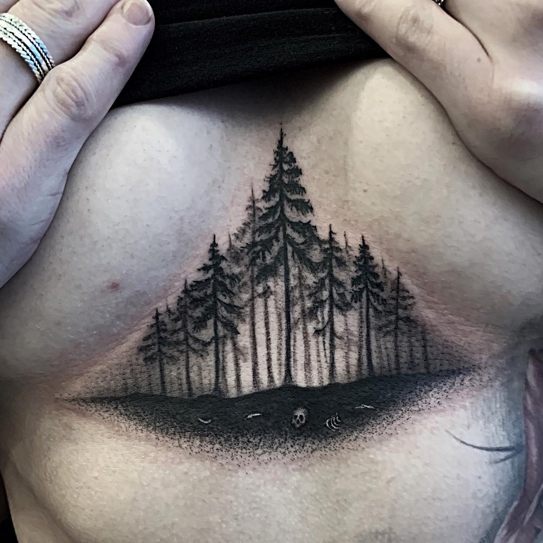 Forest and bones black and grey tattoo middle of chest triangle done by Alan Lott. Book your next custom tattoo at Sacred Mandala Studio- Custom Tattoo and Art Gallery for the Triangle of North Carolina- Raleigh, Durham and Chapel Hill