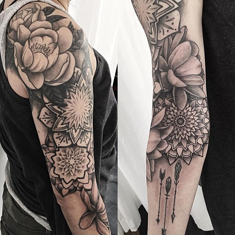 Partial arm sleeve tattoo created by Alan Lott - black and grey fine line tattoo of mandalas and peonies at Sacred Mandala Studio in Durham, NC.