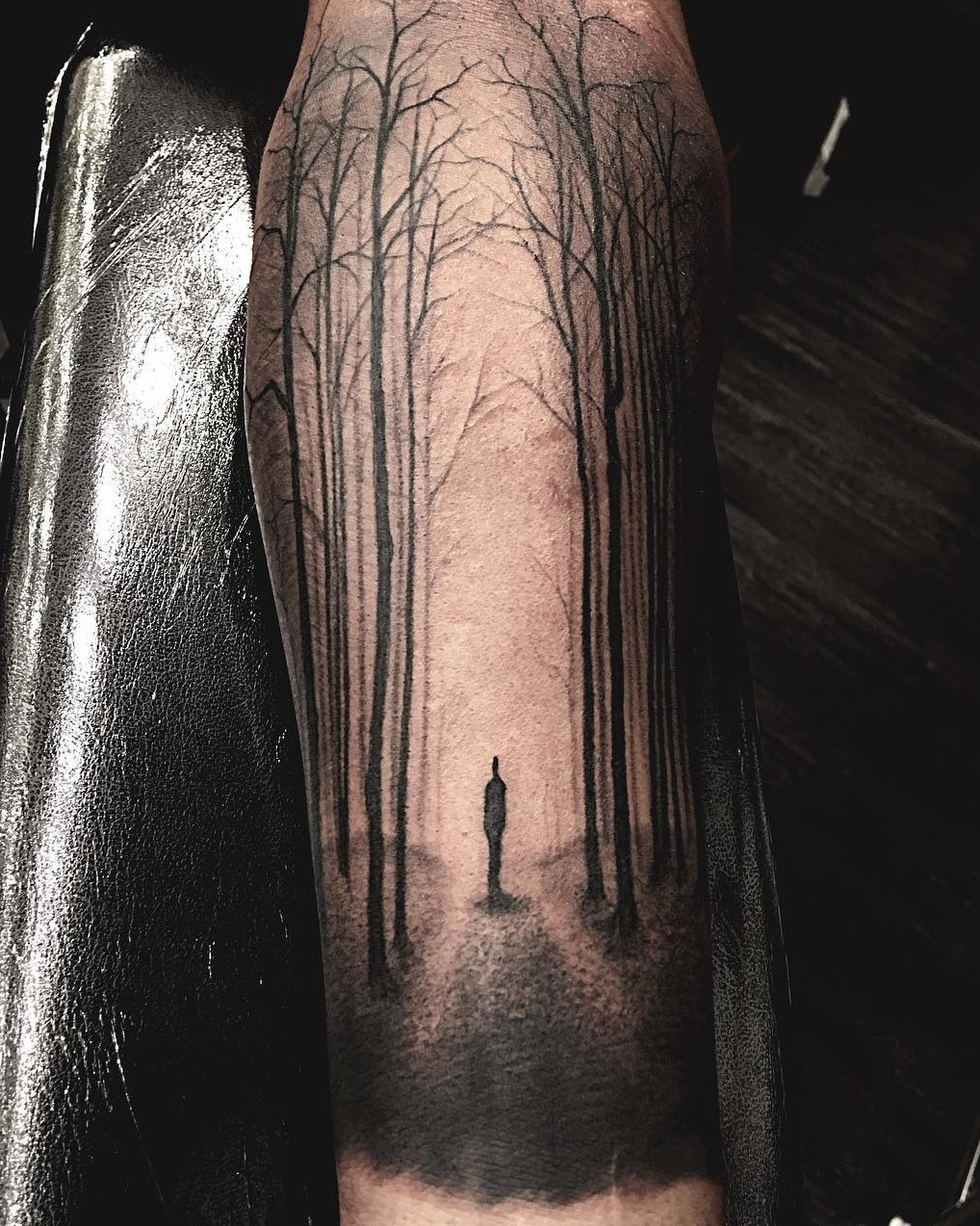 Shadow of a Person standing in the light of a forest black and grey tattoo done by Tattoo Artist Alan Lott at Sacred Mandala Studio in Durham, NC.