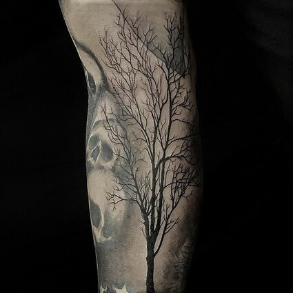 Alan Lott - forearm tattoo of a single backlit tattoo done in black and grey.