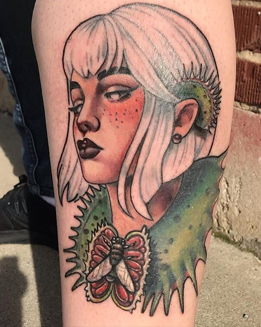 Lady with a venus fly trap tattoo artist Madison Tease of Sacred Mandala Studio. Madison is available for bookings in Durham, NC at Sacred Mandala Studio - Tattoo Shop and Art Gallery.
