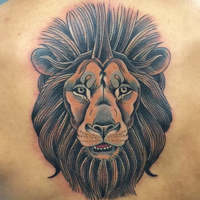 Color tattoo of a lion head created by tattoo artist Jerry Martin II at Sacred Mandala Studio in Durham, NC.